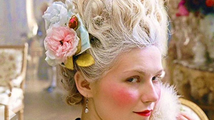 Kirsten Dunst's stylist definitely used bear grease for this updo. Probably